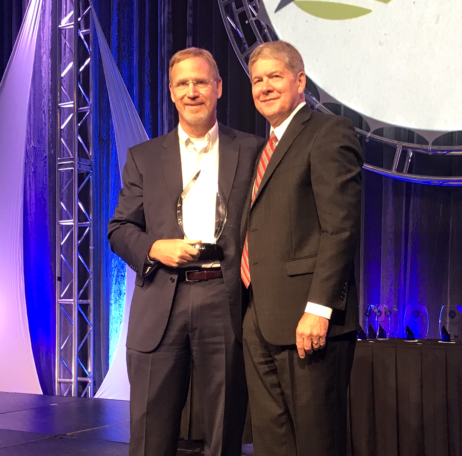 Boone County Hospital CEO, Joe Smith, being presented the 2018 Iowa Hospital Assocation Excellence in Leadership Award.